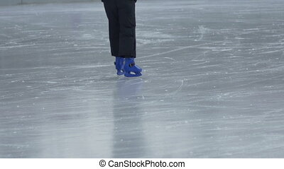 Child Leaning to Skate - A child is learning to skate and...