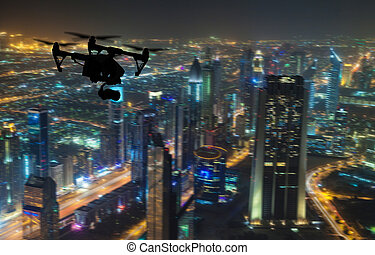 Drone silhouette flying above Dubaicity panorama - Drone...