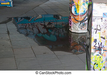 Urban scene in a city with graffiti on the walls