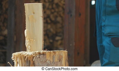 Two Logs Being Splitted ,detail - Hard swing splitting logs...