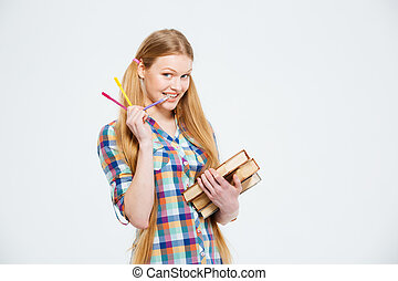 Happy female student holding books isolated on a white...