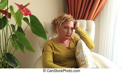 Yawning woman watching television - Portrait of a middle...