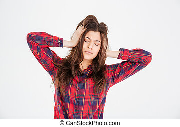 Young woman with hands on head having headache