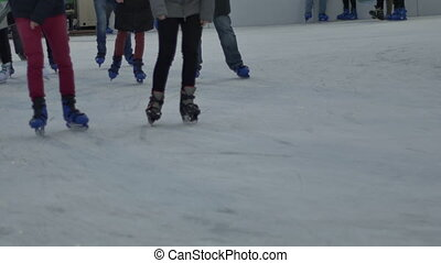 Evening Outdoor Ice Rink - People having a good time at the...