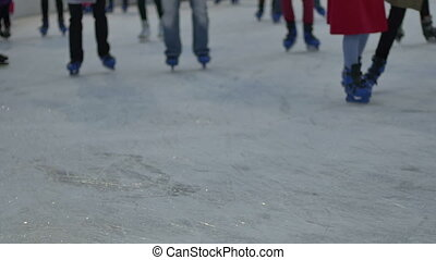 People Ice Skating - People ice skating in circle at the...