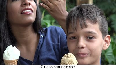 Woman And Boy Eating Ice Cream