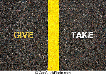Antonym concept of GIVE versus TAKE written over tarmac,...