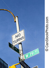 traffic sign and street name in New York under blue sky