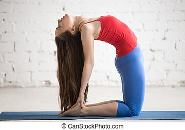 Beautiful Yoga Woman Doing Ustrasana Pose - Portrait of...