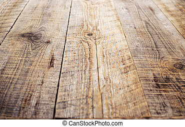 Brown wooden table made of rough planks