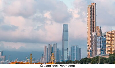 Hong Kong business center timelapse with a cloudy blue sky before sunset