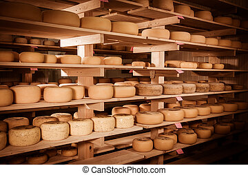 Cheese refining on shelves - Refining cheese on wooden...