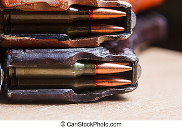 7.62 ammo for machine guns with loaded magazines on table