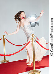 Woman falling on red carpet - Young woman falling on red...
