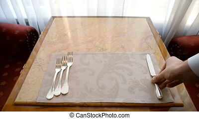 Setting with Plate, Knifes and Forks . This set has often served.