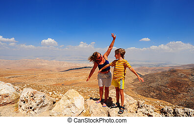 Woman And Boy Posing On The Judea Mountain Top