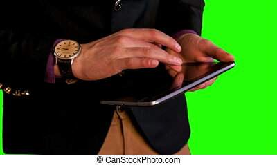 man hands work with tablet green screen