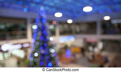 Blurred background of Christmas tree in store