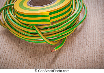 Insulation tape electrical wires on wood board directly...