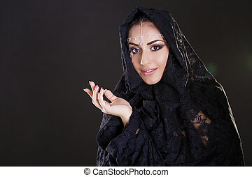 Beautiful Woman in Middle Eastern Niqab veil on isolated...