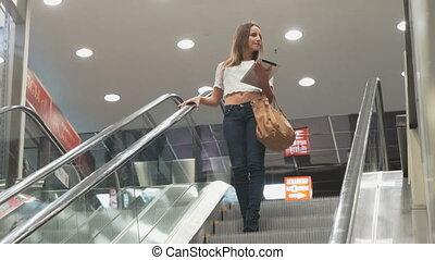 Stylish beautiful girl holding digital tablet and rides on...