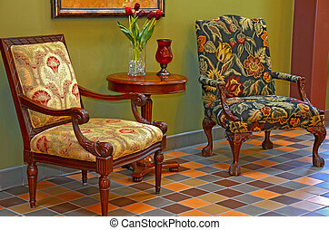 floral chairs in foyer - Uphostered floral chairs on tile...