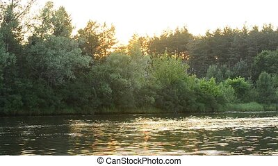 Sunset on a small lake or river in summer
