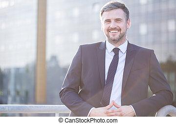 Smiling elegant boss
