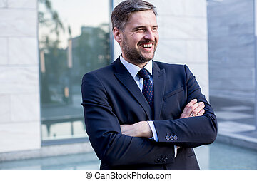 Self-confident handsome businessman in elegant suit