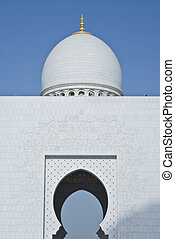 The dome and an arch at a mosque - A detail of the door and...