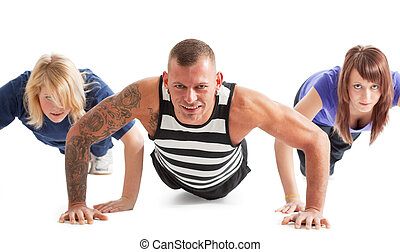 press-up - Group of three people working out; selective...