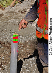 seismic reflective survey - Man lowering an explosive charge...