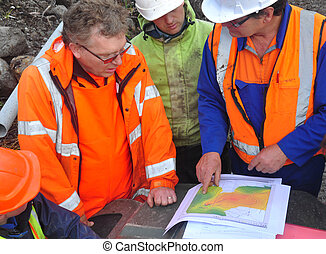 seismic discussion - Geologists discuss the oil-bearing...
