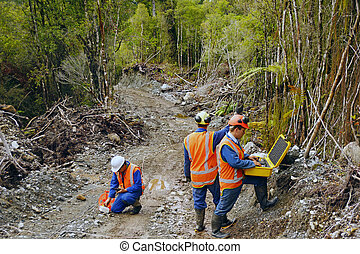 seismic reflective survey - Men setting off explosive...