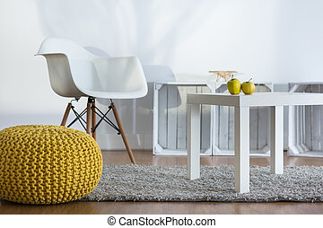 Cozy relaxation space in modern designed loft - Yellow pouf,...