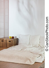 Simple bed in raw modest bedroom - Modest bedroom with...