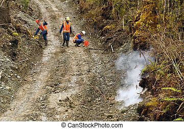 seismic reflective survey - Men setting off explosive...