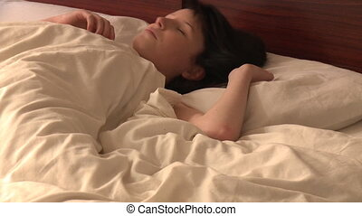 Portrait of pretty woman sleeping  lying in bed