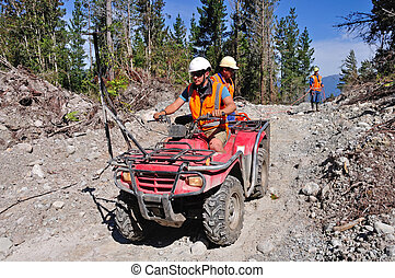 seismic reflective survey - Men use an all terrain vehicle...
