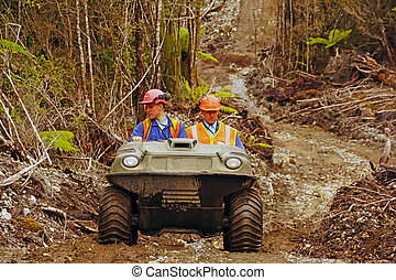 all terrain team - Men travel in an all terrain vehicle...