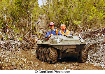 all terrain team - Men travel in an all terrain vehicle...