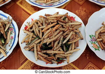 ASIA SOUTHEASTASIA LAOS VIENTIANE - fry insects at a...
