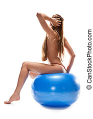 beatiful nude woman sitting on ball, isolated on white