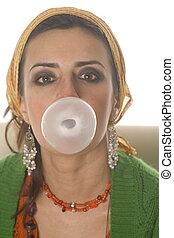 Bubble gum - Playful girl blowing bubble with bubble gum...