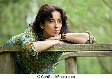 beautiful pensive woman - pensive woman relaxing in park at...