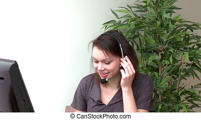 Cute woman with headset on - Jolly woman with headset on...