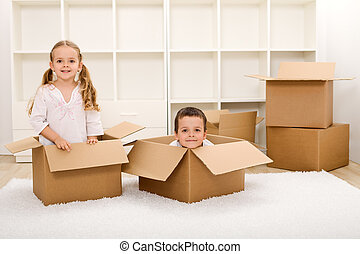 Kids in their new home with boxes