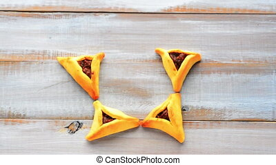Star of David Hamentashen - Woman hand creating a Star of...