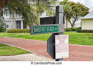 Barefoot Beach Blvd street sign