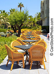 Al fresco wicker seats on the mediterranean hotel terrace,...